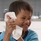 boy using paper towel