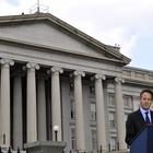 Treasury Secretary Geithner in front of the Treasury