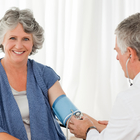 Woman having her blood pressure taken