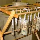 Federal Reserve Notes on a drying rack