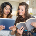 women reading book and ebook
