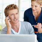Young couple talking to credit card company