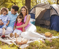 Family using camping hacks for their adventures