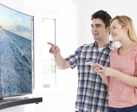 Couple buying best 4K TV