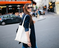 Woman using things she already owns to make a tote bag