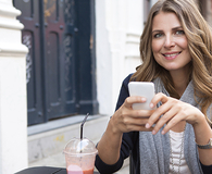 her smartphone is saving her money