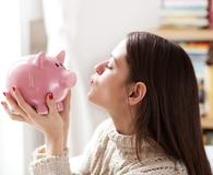 Kissing piggy bank