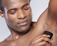 Man using best deodorant for men to battle sweat