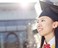 Woman buying stocks every recent grad should own