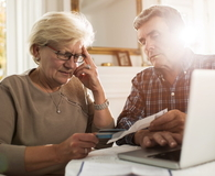 Old couple having problems with their home finances