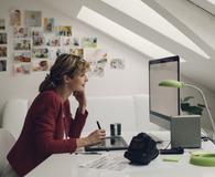 Photographer Editing Photos on her computer