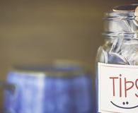 Tip jar in coffee shop or restaurant