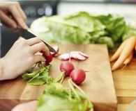 Woman learning delicious ways t enjoy summer veggies
