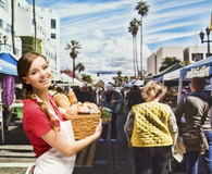 Woman deciding what to buy at the farmer's market and what to skip