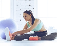 Woman learning how fitness can improve her finances
