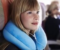 Woman using the best travel pillow
