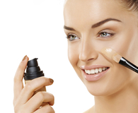 Woman applying best concealers on her face
