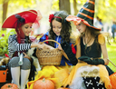 Trick-or-treaters eating Halloween treats they love