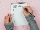 Woman writing down goals for 2020