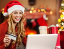Beautiful woman shopping online for Christmas