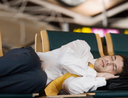 businessman sleeping airport