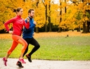 Couple running during autumn