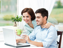 couple using laptop for banking