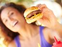 woman holding burger