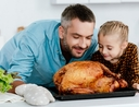 Father and daughter feeling thankful for the turkey