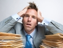 Man overwhelmed by documents