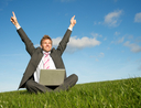 Excited businessman with laptop