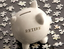 Investing money for retirement in piggy bank