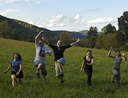 Joyful people running in a field