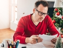 Man paying off holiday debt