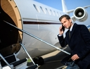 Rich man with tax secrets boarding private jet