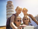 Mother and kids taking selfie in Pisa