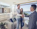 Real estate agent with couple in luxury home