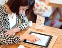 Woman using iPad at restaurant