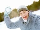 man throwing snowball