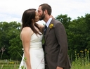 Wedding kiss in a field