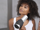 Woman using best blow dryers to blow dry hair