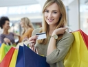 Woman using credit card on everyday spending
