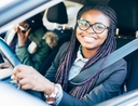 Woman using driving tips to save gas and money