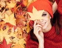 Woman enjoying fall leaves