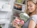 Woman holding fresh food that spoils quickly