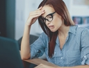 Woman wondering if she should refinance her student loan