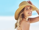 Woman wearing summer beach hat