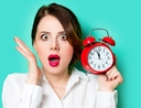 Woman using clock for time management