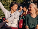 Women riding roller coaster with annual pass
