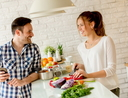 Young couple preparing healthy meal in the kitchen